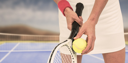 racquet: Athlete holding a tennis racquet ready to serve  against facing view of net on tennis field