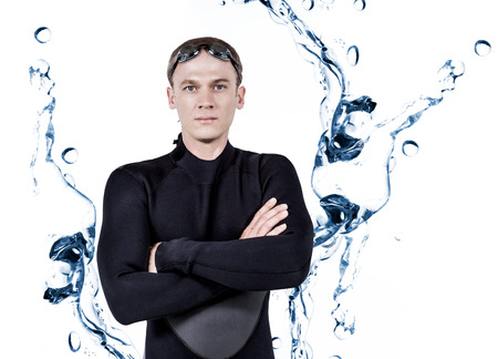 bubbling: Portrait of swimmer in wetsuit against water bubbling on white surface