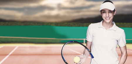 composite image: Female athlete playing tennis against composite image of tennis field Stock Photo