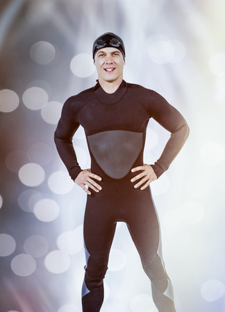 wetsuit: Portrait of confident swimmer in wetsuit against glowing background