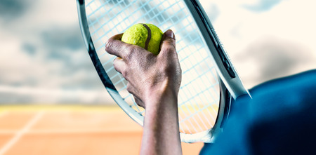 racquet: Tennis player holding a racquet ready to serve  against composite image of tennis net Stock Photo