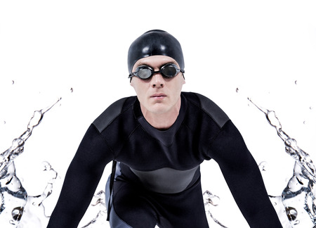 wetsuit: Confident swimmer in wetsuit against water bubbling on white surface