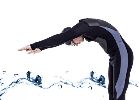 bubbling: Swimmer in wetsuit while diving against water bubbling on white surface Stock Photo