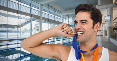 lane marker: Athlete posing with gold medals around his neck against empty swimming pool with large windows