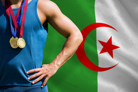 algerian flag: Portrait of sportsman chest with medals  against algerian flag Stock Photo