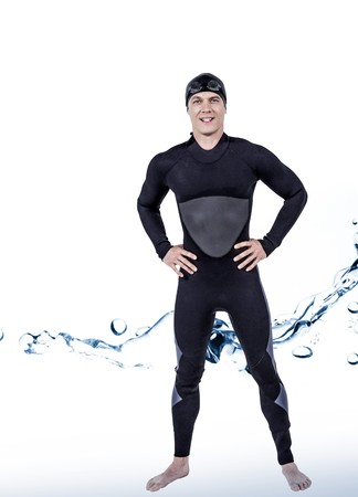 bubbling: Portrait of confident swimmer in wetsuit against water bubbling on white surface Stock Photo