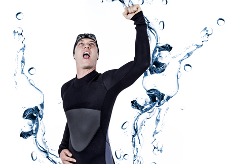 bubbling: Swimmer posing after victory against water bubbling on white surface Stock Photo