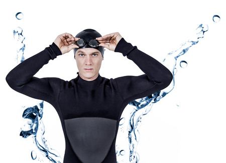 bubbling: Swimmer in wetsuit wearing swimming goggles against water bubbling on white surface