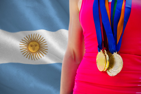 argentinian flag: Portrait of sportswoman chest with medals  against argentinian flag