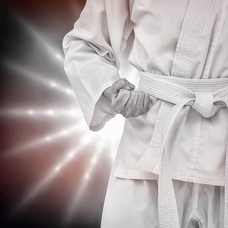 karateka: Fighter performing karate stance against spotlight