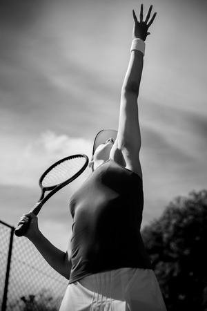 tennis skirt: Pretty tennis player about to serve on a sunny day