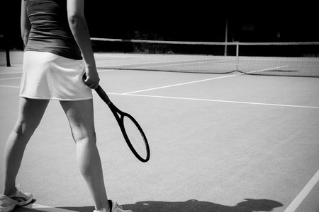 tennis skirt: Tennis player standing on court on a sunny day Stock Photo