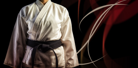 female fitness: Mid section of karate player against black background Stock Photo