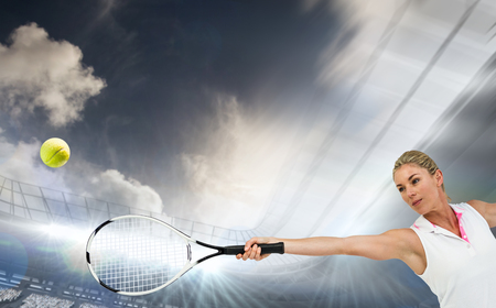 racket stadium: Athlete playing tennis with a racket  against football stadium with fans in white Stock Photo