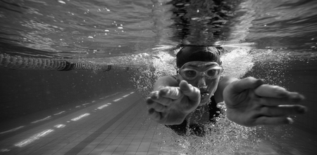 leisure centre: Athletic swimmer training on her own in the swimming pool at the leisure centre
