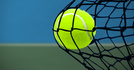 bi: Tennis ball with a syringe against digitally generated image of bi colored background