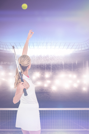 digitally generated image: Athlete holding a tennis racquet ready to serve  against digitally generated image of tennis court and spotlight Stock Photo