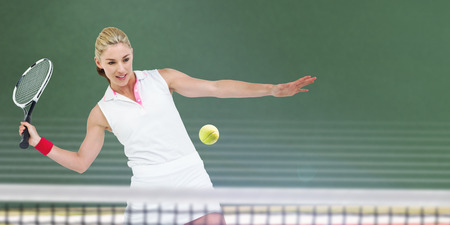 digitally generated image: Athlete playing tennis with a racket  against digitally generated image of bi colored background Stock Photo