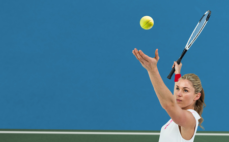 bi: Athlete holding a tennis racquet ready to serve  against digitally generated image of bi colored background