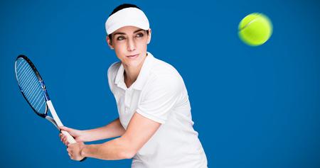 royal blue: Female athlete playing tennis against royal blue