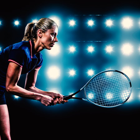 digitally generated image: Tennis player playing tennis with a racket  against digitally generated image of blue spotlight