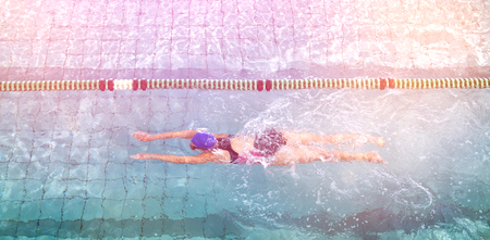 leisure centre: Female swimmer training by herself in swimming pool at the leisure centre