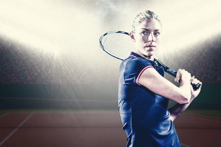 digitally generated image: Tennis player playing tennis with a racket against digitally generated image of luminous tennis court