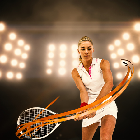 digitally generated image: Athlete playing tennis with a racket  against digitally generated image of spotlight Stock Photo