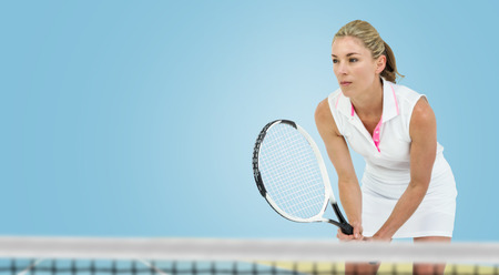 bi: Athlete playing tennis with a racket  against digitally generated image of bi colored background Stock Photo