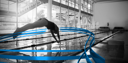 lane marker: Woman diving in swimming pool  against feet of woman standing on the edge of the pool