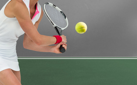 digitally generated image: Athlete playing tennis with a racket  against digitally generated image of bicolored background