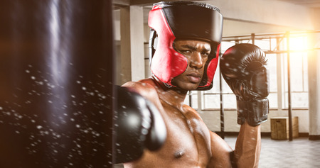 punched out: Boxer performing upright stance against interior view of a gym Stock Photo