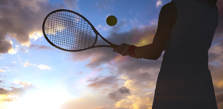 against the sun: Athlete playing tennis with a racket  against sun shining