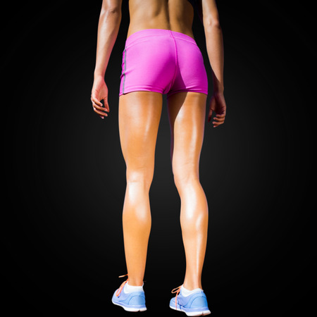 woman close up: Close up of sportswoman legs with sweat in a black background