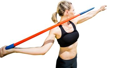 30s: Sportswoman preparing to javelin throw on a white background