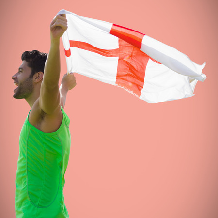 profile view: Profile view of sportsman holding an England flag against salmon background