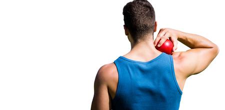 lanzamiento de bala: Vista trasera de un deportista practicando su lanzamiento de peso Foto de archivo