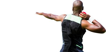 shot put: Vista trasera de un deportista practicando su lanzamiento de peso Foto de archivo
