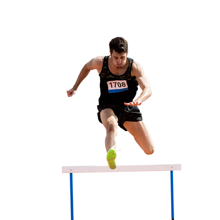 hurdles: Sportsman practicing hurdles in a white background Stock Photo