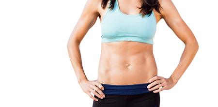 thirties: Portrait of sportswoman chest is posing on a white background
