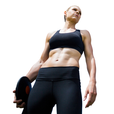 sportswoman: Low angle view of sportswoman holding a discus on a white background