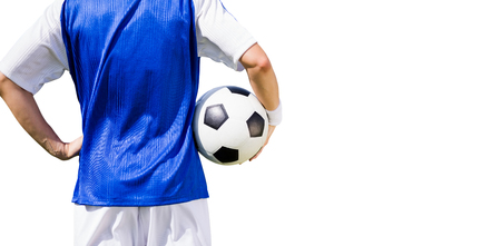 rear view: Rear view of football player holding a football on a white background Stock Photo