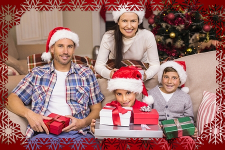 Composite image of happy family portrait on a Christmas frame photo