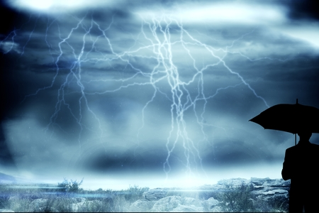 composite image: Composite image of woman figure is holding an umbrella on a stormy day