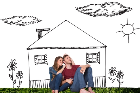 composite image: Composite image of young couple is sitting in front of house drawing on a white background