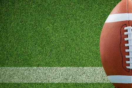 composite image: Composite image of an american football against a field