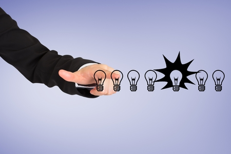 composite image: Composite image of businessman is touching light bulb drawn on a screen Stock Photo