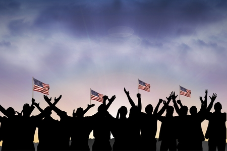 composite image: Composite image of figures is shaking american flags on sunset