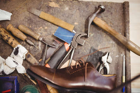 brogue: Tools of cobbler and a shoe on a table in a workshop LANG_EVOIMAGES
