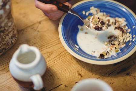 homey: Close up view of bowl of muesli on wooden table